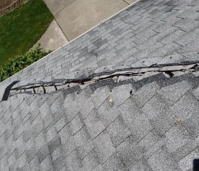 Roof of a home with damage to shingles