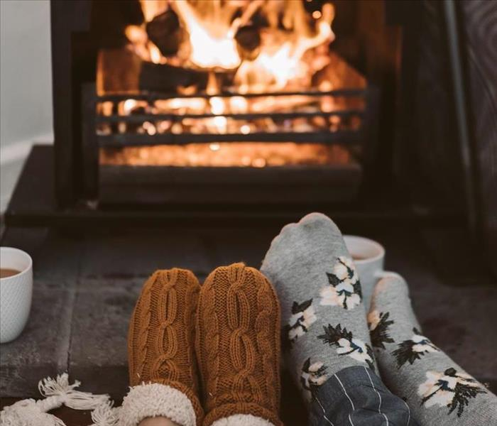 Photo by Taryn Elliott from Pexels - image of socks in front of fireplace